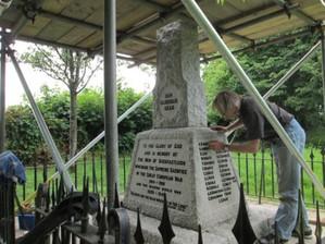 Painting the raised lead letters on the granite die