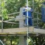 Up on scaffolding cleaning the cross